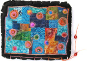 Colourful sketchbook with hand and machine embroidery.